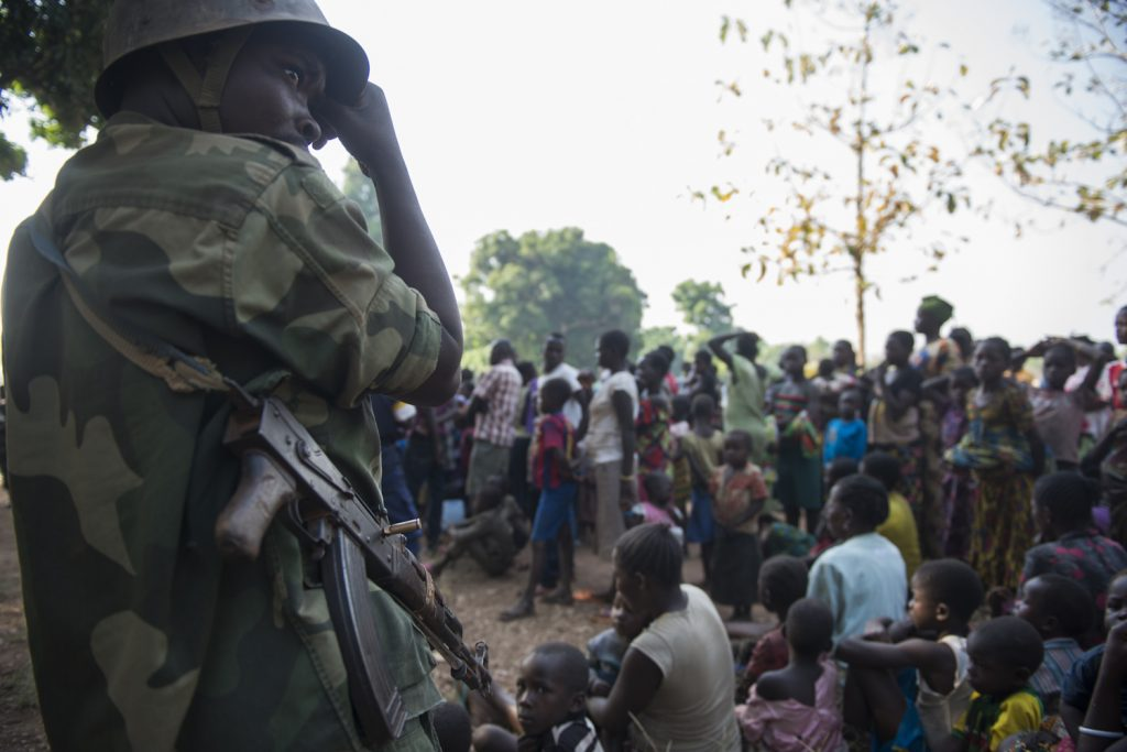 Congolese military keep an eye on South Sudanese refugees during the registration by UNHCR in Bitima village. Since November, thousands of refugees have fled from Western Equatoria to northern DRC.