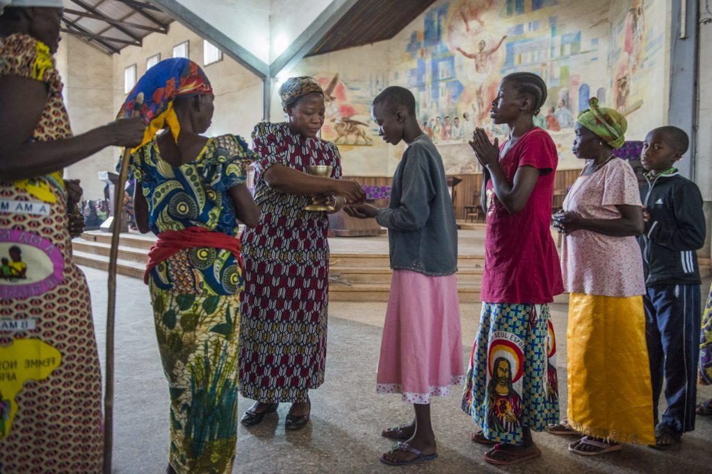 Sister Angelique, winner of the Nansen Award in 2013 for her work with 2,000 women and girls who were victims of LRA, giving communion at the Sunday mass in Dungu Cathedral.