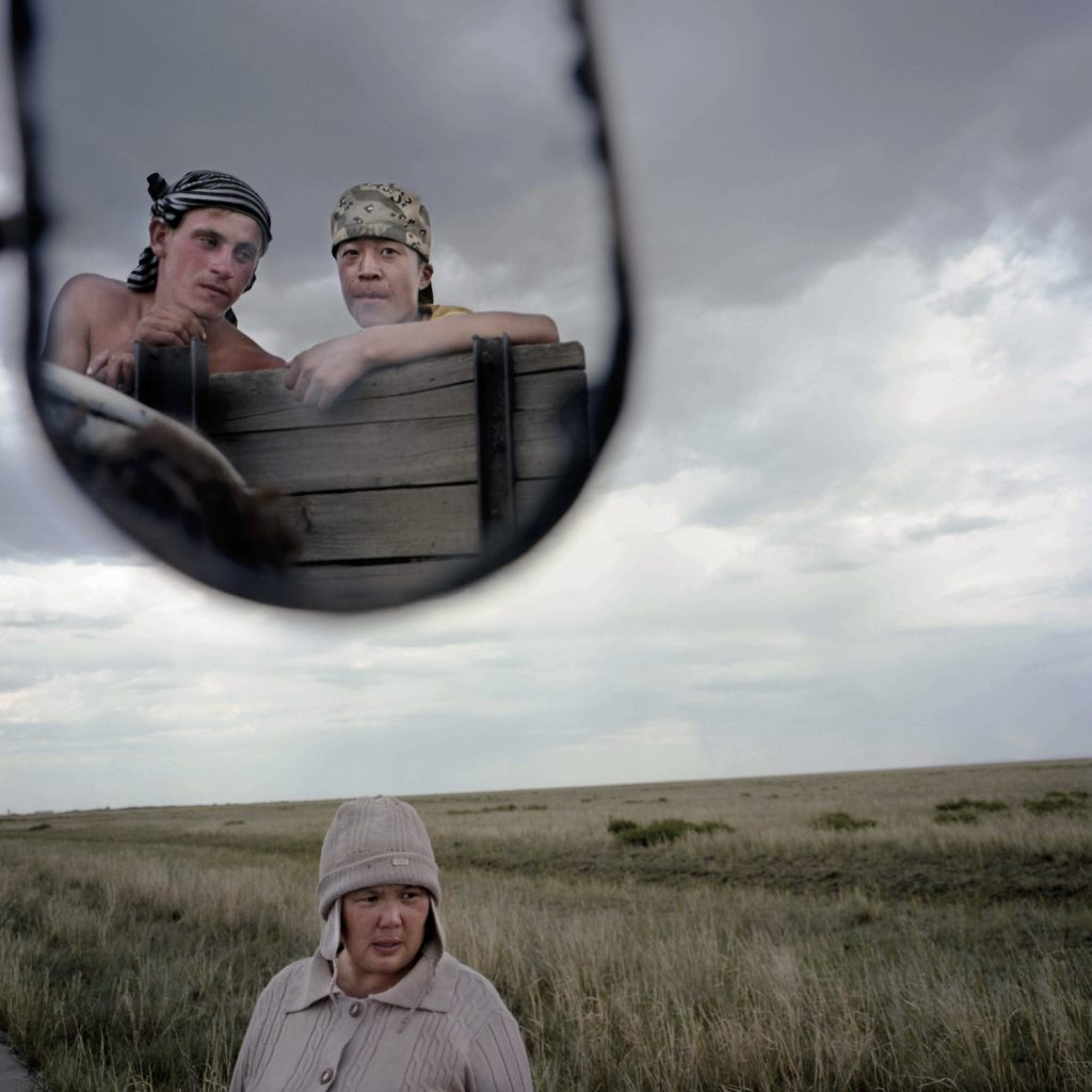Alya, a kazakh woman, watches her son and his russian friend.