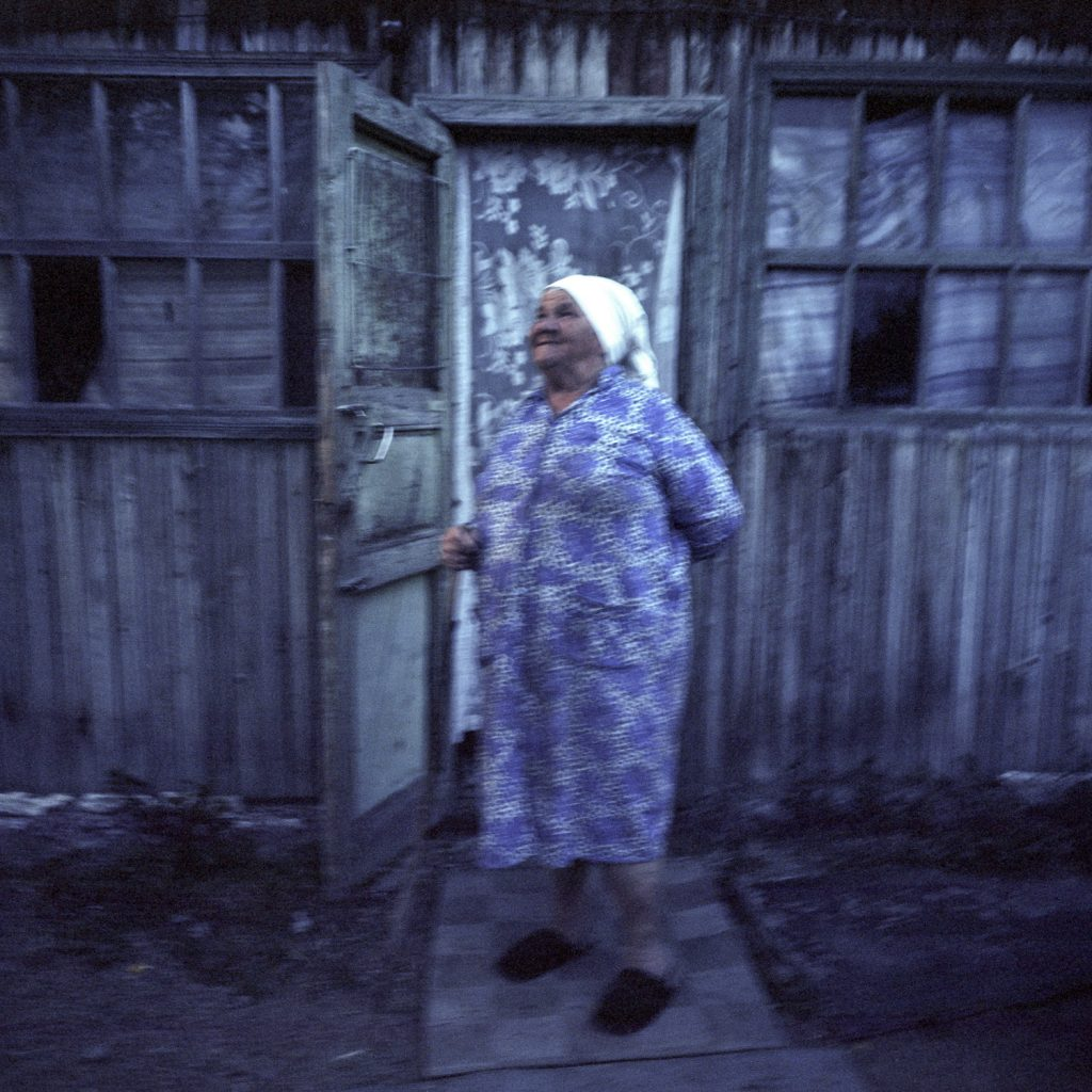 Valer's mother, Baboushka Tonia, 81 years old, in front of her son's home. She arrived in Shagan in 1956.